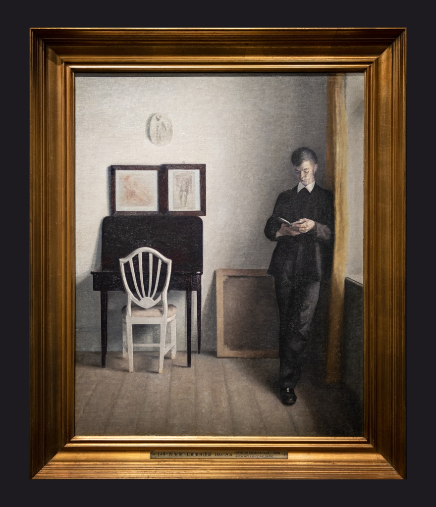 10 1898 Interior With A Young Man Reading by Leslie Hossack